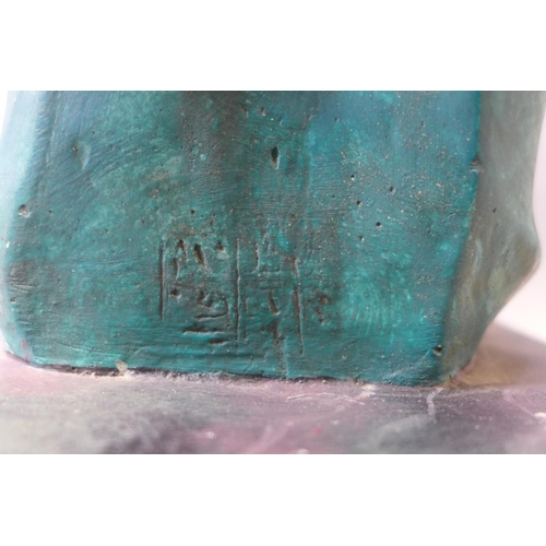 91 - A turquoise cast plaster Egyptian style head, indistinctly signed to reverse, on faux marble cast pl...