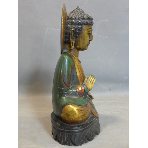 92 - An Indonesian carved and polychrome painted wooden seated Buddha, H.55cm...