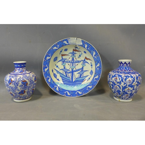 97 - A collection of Turkish pottery, to include two vases (one repaired); two cups, and a baluster shape...