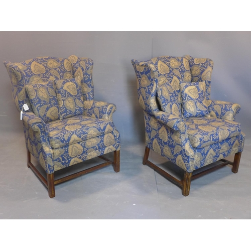 103 - A pair of 20th century wingback armchairs, with Jane Churchill Limited designer fabric, on square re...