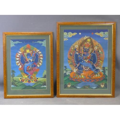 109 - Two Nepalese paintings on silk of Hindu deities in mandorlas, in walnut veneered frames (chips to ve...