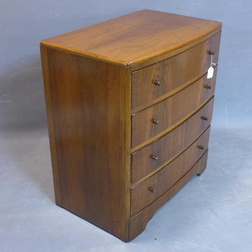 121 - A walnut bowfronted chest of four drawers, on bracket feet, H.85 W.76 D.48cm...