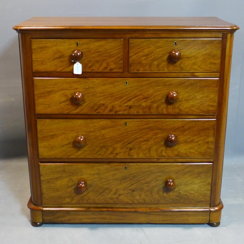 123 - A Victorian walnut chest of two short over three long drawers, on pedestal base and bun feet, H.104 ...
