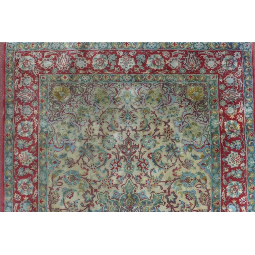128 - An antique part silk Persian Isfahan Sarafian rug, central floral medallion and stylised flowers on ...