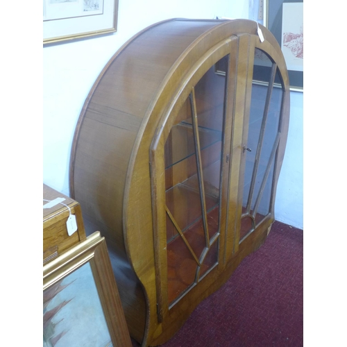 151 - A 1940's Art Deco style walnut circular glass fronted display cabinet, the astragal glazed doors enc...