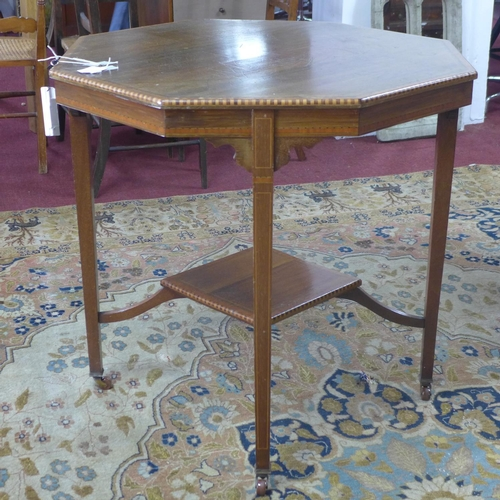 152 - An Edwardian mahogany octagonal inlaid occasional table, with undertier, raised on tapering legs and...