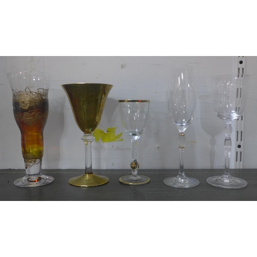 259 - A collection of fourteen various extravagant wine glasses...