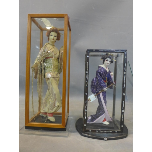 289 - Two Japanese dolls, one holding a samisen, in mother of pearl inlaid display case, H.27.5cm (doll), ...
