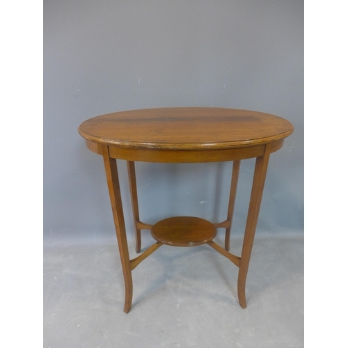 509 - An Edwardian mahogany oval top occasional table, with undertier, raised on outswept legs, H.72 W.69 ...