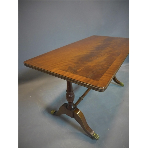 511 - A mid 20th century mahogany occasional table, with cross-banded top raised on turned supports and ou...