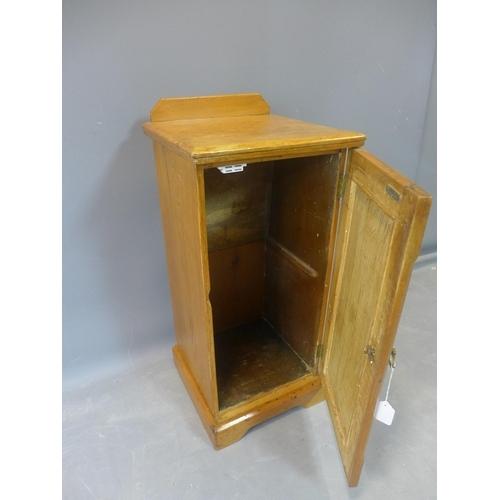 513 - A Victorian pitch pine bedside cupboard, H.85 W.38 D.38cm...