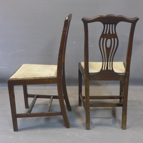 522 - A pair of Edwardian Hepplewhite style mahogany dining chairs, with shaped back splats and shaped top...