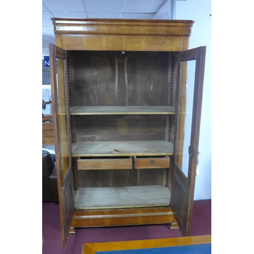 537 - A large 19th century French fruitwood bibliotheque display cabinet, with a pair of glazed and panell...