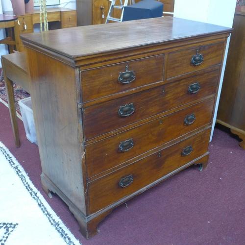543 - A 19th century mahogany chest of 2 short over three long graduated drawers, raised on bracket feet, ...