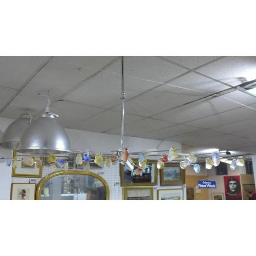 557 - An Italian designer six light chandelier by IDR, H.74 W.125 D.75cm...
