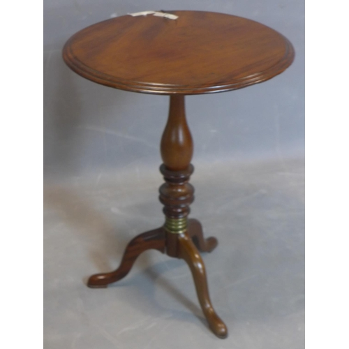 572 - A 19th century mahogany wine table, with moulded round top above baluster turned support and tripod ...