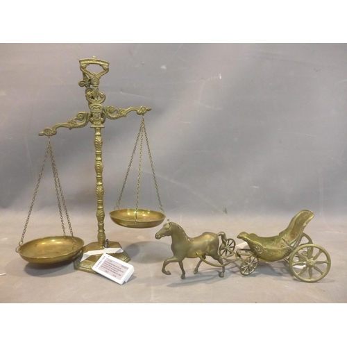 593 - 20th century large brass table scales and a horse with a chariot