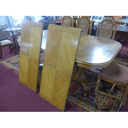 520 - A fruitwood extendable dining table, with two pedestals on turned supports, H.75 x W.285 x D.115cm...