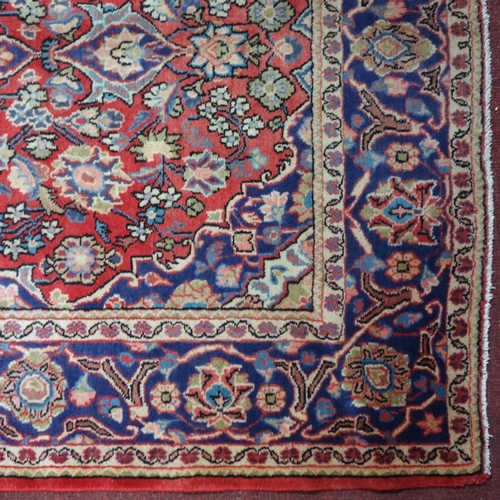 611 - A Central Persian Kashan rug, central floral medallion with repeating spandrels and petal motifs on ...
