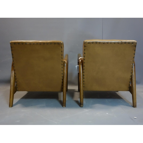 621 - Two 1950's oak stud bound leather armchairs, H.75 W.64cm