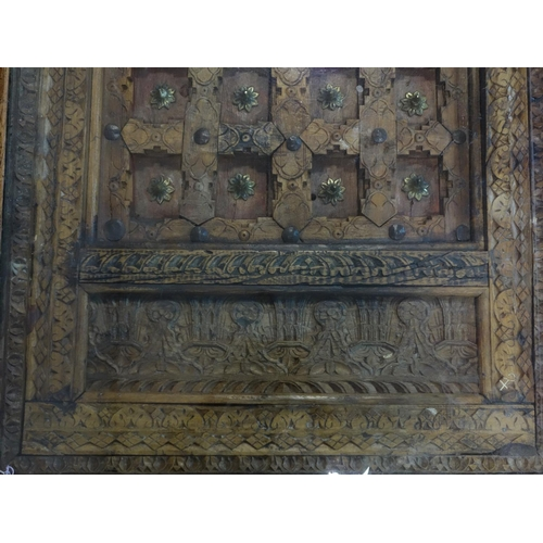 622 - A large Indian brass clad hardwood table, carved and pierced with glass top, on turned legs, H.45 W....