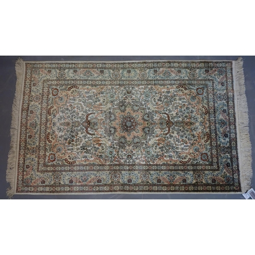 624 - A Persian pure silk Herek rug, central floral medallion with stylised floral motifs on an ivory grou...