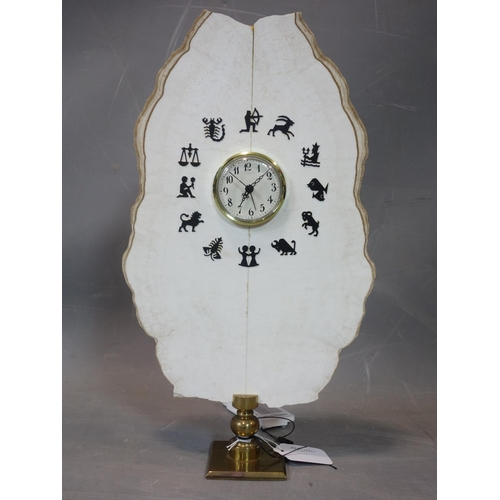 626 - A contemporary table clock made from a white precious stone slate with zodiac signs...