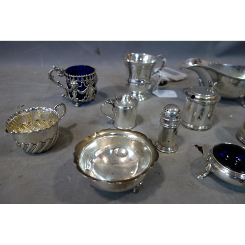 16 - A collection of silver items including three mustard jars, three milk jugs, and one salt cellar and ...
