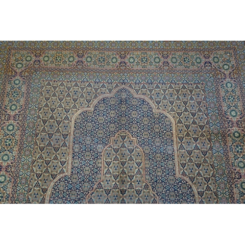 387 - A Central Persian Kirman carpet with central diamond double pendant, with repeating petal motifs, su...