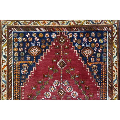 391 - A South West Persian Qashqai carpet, the single pole medallion with repeating animal motifs, on a te...