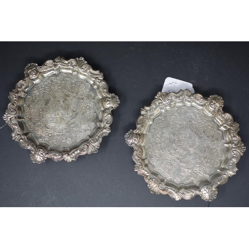 40 - A pair of George II silver salvers by Benjamin Godfrey, London 1739, each circular and on three reed...