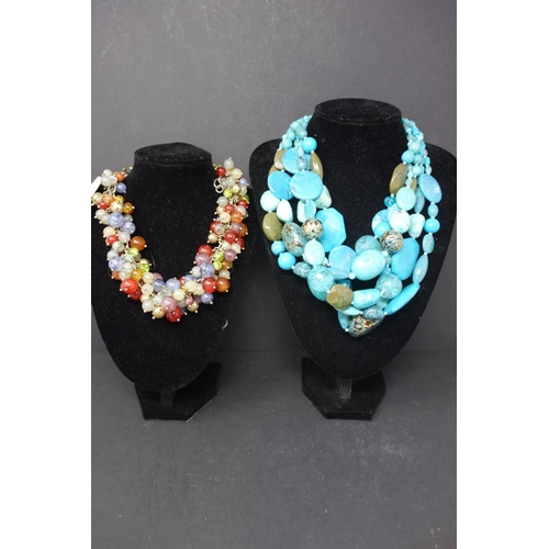 534 - Two turquoise plastic and colorful glass beads...
