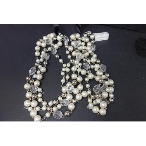 536 - Five multicoloured extravaganza lady necklaces...