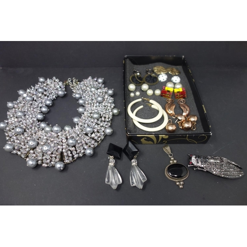 537 - An ornate beaded necklace and a box of earrings, brooch, necklace etc...