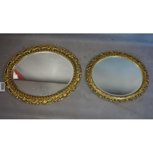 589 - Two oval gilt mirrors...