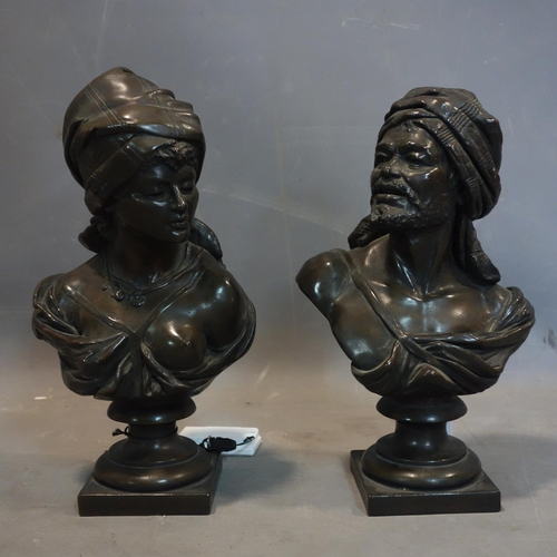 540 - A pair of 20th century bronze busts of an Arabian man and woman, H.30cm...