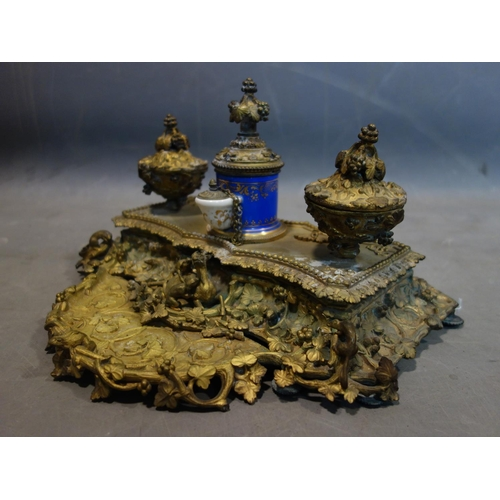 541 - A 19th century French ormolu ink desk stand, with central porcelain pot and applied animals, H.20 W....