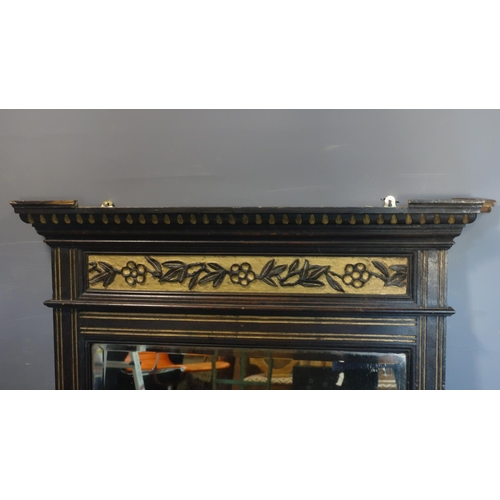 592 - A Victorian ebonized and part gilt over mantle mirror with bevelled plate, 100 x 91cm...