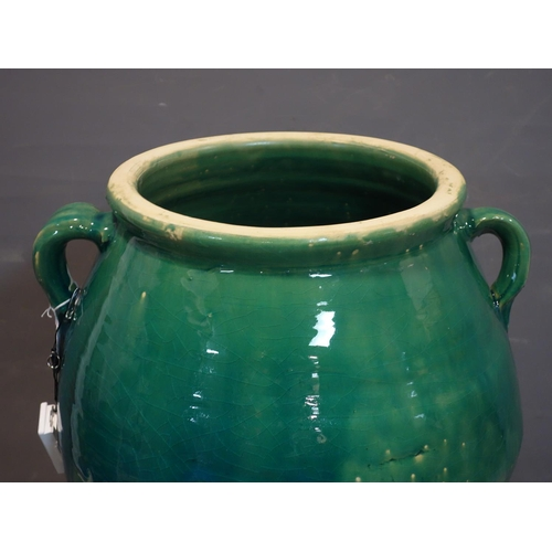 523 - A Persian green glazed Sharab wine vessel, H.73cm...