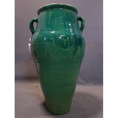524 - A Persian green glazed Sharab wine vessel, H.76cm...