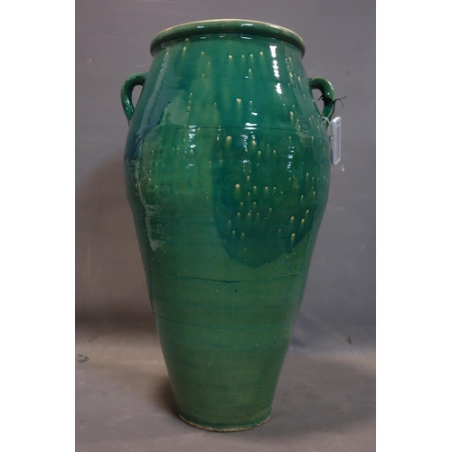 525 - A Persian green glazed Sharab wine vessel, H.76cm...