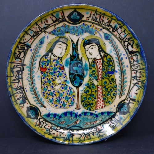 527 - A Persian glazed ceramic plate, made in Tehran, date and makers mark to reverse, depicting a Persian...