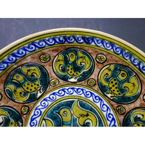 528 - A Persian glazed ceramic plate decorated with birds each representing a human fault, inspired by The...