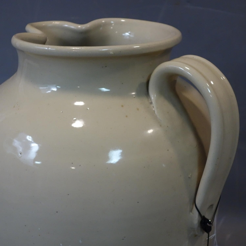 604 - Large size stoneware jug by Doulton & Co. Ltd of Lambeth, H.49 , diameter 40 cm...