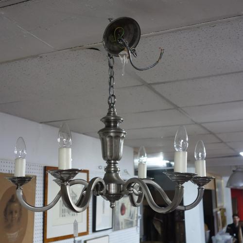 571 - A contemporary chandelier...