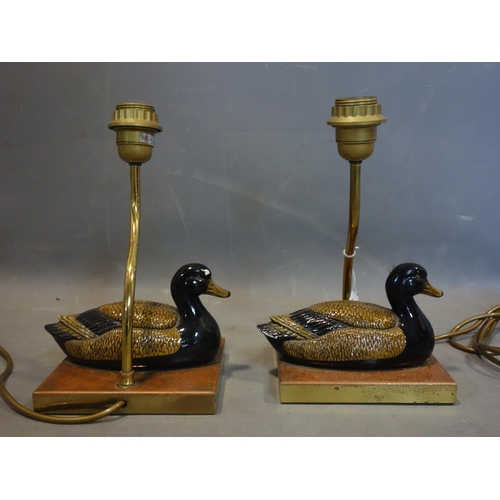574 - A pair of brass table lamps with ceramic models of ducks, with label tag for Christopher Wray...