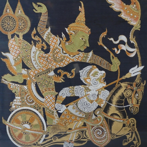 509 - Contemporary Thai artist, warrior on a chariot (Dwarapala?), gutta pigments on bue silk, framed and ...