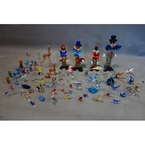 588 - A collection of glass figures, to include four Murano glass clowns, H.31cm (largest); a Mdina horse ...