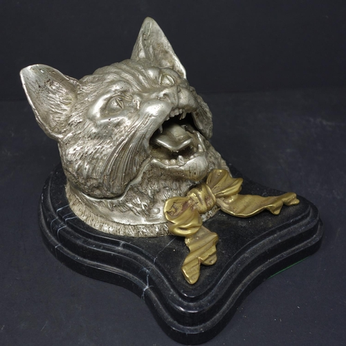 522 - A silver plated inkwell modelled as a cat, with hinged lid (missing inkwell), mounted on stepped mar...