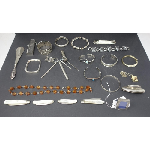 519 - A mixed collection of silver and silver plated items, to include silver bangles, containers, silver ...